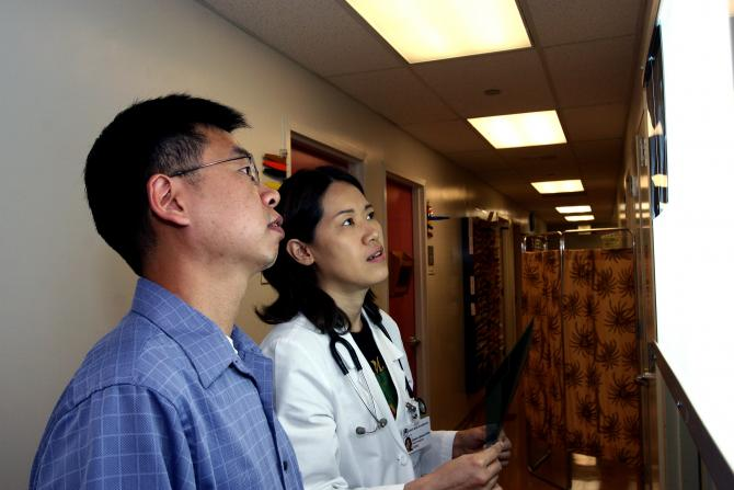 Doctors analyze patient scans