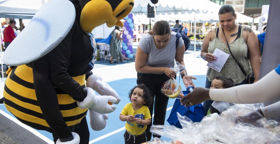 UHP mascot with young visitor at WIC Breastfeeding Expo 2019 (Bronx, NY). Photo by Romina Hendlin.